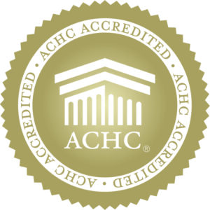 ACHC Accreditation seal with house in gold sealed banner